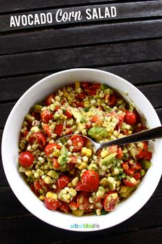 Avocado Corn Salad recipe. This colorful, vibrant, and versatile salad is packed with fresh tomatoes, corn, and avocado. It's the perfect side salad for summer picnics and BBQs, or even as a relish for hot dogs or dip for chips!