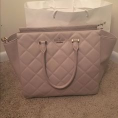 Kate Spade Emerson Place Hayden This is a Kate Spade Emerson Hayden in the color mousse frosting. This bag has been used, but is in excellent condition. There is a very tiny Mark at the bottom of the bag. Comes across body strap, tag, Carichar, dust bag. Price is negotiable.❌TRADES❌ kate spade Bags Satchels