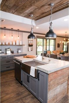 The barnyard ceiling references the kitchen's wood island and flooring