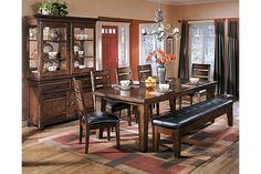 """The Larchmont Dining Room Table from Ashley Furniture HomeStore (AFHS.com). With grand Old World design and a rich finish, the """"Larchmont"""" dining room collection brings a classic beauty to the decor of any dining experience."""