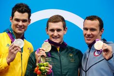 London Olympics: Day Two - Breaststroke medal winners - South Africa's Cameron van der Burgh (C), Australia's Christian Sprenger (L) and Brendan Hansen of the US pose with their gold, silver and bronze medals during the men's 100m breaststroke victory ceremony at the London 2012 Olympic Games July 29, 2012. Van der Burgh also set a world record time of 58.46 seconds. Reuters: David Gray