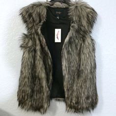 NWT Chic JS Faux Fur Sleeveless Vest Super cute and super chic faux fur vest. Improve any outfit just by adding this vest to your wardrobe. It has unique shoulders that adds a touch to the vest. Making it more unique and girly. It's size Small, but might fit a Medium & definitely an XS. It has a hook on the top, so you can close it if you need. Very versatile. Can be dressed up or down. Jessica Simpson Jackets & Coats Vests