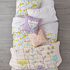 Adorned with soft, stylish flowers, this floral bedding set will instantly freshen up any kids room. The appliqued quilt reverses to solid pink, making it like two quilts in Toddler Girl Bedding Sets, Girls Bedding Sets, Kids Bedroom Sets, Comforter Sets, King Comforter, Pink Bedding Set, Floral Bedding, Luxury Bedding Sets, Bedding Shop