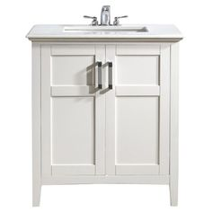 Add classic style to your master bath or powder room with this vanity. Showcasing a lacquer-finished wood base, and white countertop, this eye-catching desig...