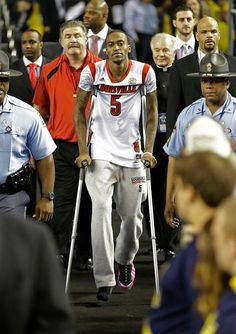 Louisville guard Kevin Ware walks out to the court before the first half of the NCAA Final Four tournament college basketball championship game against the Michigan, Monday, April 8, 2013, in Atlanta. (AP Photo/David J. Phillip)