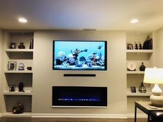 Love this look of my new built in wall unit with TV over fireplace. My TV looks like a built in fish tank so serene. in fish tank ideas Built In Wall Units, Home Room Design, Diy House Renovations, Fireplace Tv Wall, Living Room Wall Units, Contemporary Living Room Design, Living Room Tv Unit Designs, Living Room Tv Wall, Wall Units With Fireplace