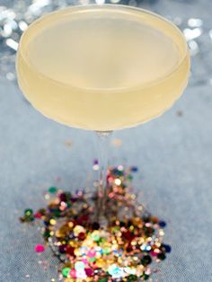 French 75 Cocktail - 1 1/2 oz Gin, 1/2 oz St. Germain, 1/2 oz Lemon Juice, 1/4 oz Simple Syrup, Champagne or Sparkling Wine