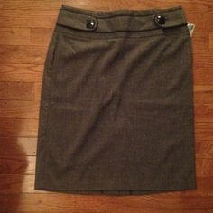 Pencil skirt Dark gray pencil skirt with black detailing and buttons. Has slit that goes 1/4 way up skirt on back. Has extra button. Brand new never worn. Size 7/8. Maurices Skirts Pencil
