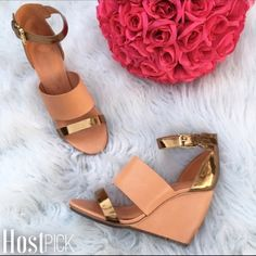 Final Price| Rebecca Minkoff leather wedge Gorgeous pair of Rebecca Minkoff leather wedge in a stunning cantaloupe color with bronze details. New without tags. Color is more like retail photo. Made in Brazil. Poshmark editor pick! 3.18.15 Host pick 5.8.15 Rebecca Minkoff Shoes Wedges