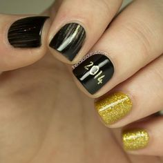 Ring in the new year on your nails first by making a 2015 accent nail. An assortment of stripes and glitter nails completes the look. #newyears #nails