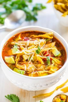 Easy 30-Minute Homemade Chicken Tortilla Soup - Chicken, tomatoes, corn, black beans, avocado, cheese, and addictively crunchy tortilla strips! Fast, easy weeknight meal, and better than from a restaurant!! More