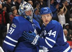 TORONTO, ON - NOVEMBER 8: Goalie Frederik Andersen #31 of the Toronto Maple Leafs is congratulated by teammate Morgan Reilly #44 after defeating the Minnesota Wild during an NHL game at the Air Canada Centre on November 8, 2017 in Toronto, Ontario, Canada. The Maple Leafs defeated the Wild 4-2. (Photo by Claus Andersen/Getty Images)