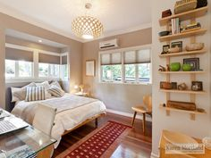 cute bedroom with mounted bookcase