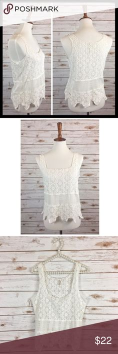 """free people // white lace scalloped hem tank top This darling tank from Intimately Free People has a semi sheer lace body, contrast waist and scalloped hem. It's perfection with jeans or cut offs for that boho chic look you love. 60% cotton, 40% polyester. Gently worn a couple times and in great preowned condition. Underarm to underarm measures 18"""" across lying flat. 23.5"""" long from top of shoulder to bottom of scallop. Free People Tops Tank Tops"""
