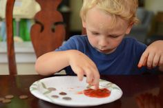 teaching kids about acidity, or a simple sensory activity for toddlers -- cleaning pennies with ketchup.