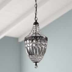 """null Hanging from an adjustable 3' chain (and 6' wire), this 1-light pendant will put a little sparkle in any room. Its curved urn silhouette has a 5"""" diameter and bronze metal finish, with perfectly polished details against its crystal-covered shade. After assembling, place one 60W B11 standard bulb (not included) in the E12/candelabra bulb base for optimal shine, whether you display it in a space that's traditional or glam.Give it your own spin: Rather than suspending it midair, you can…"""