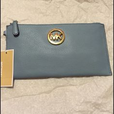 Leather clutch Gorgeous powder blue leather clutch. Has 6 slots for credit card and is big enough even for iPhone 6 Plus Michael Kors Bags Clutches & Wristlets