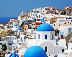 Photograph of Santorini Greece. Santorini was everything I had dreamed of and unlike anything I had imagined. Brilliant blue skies framing whitewashed homes clinging to cliffs. Bright blue domes and white churches. Full of light and beauty.