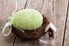 Wrap plastic eggs with yarn or other fabrics to make unique decorations that can be reused for many Easters to come!