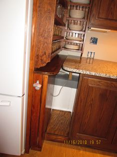 "You can see the concrete ledge behind the base cabinets and behind the refrigerator. The base cabinets are 18"" deep by 35"" tall by 36"" wide, so they are not normal 24"" deep base cabinets. The 18"" base cabinets plus the 13"" deep concrete ledge required a deeper than normal countertop. That was a blessing, because the used countertop was 34"" deep by 118"" wide by 1.25"" tall. I LOVE the deep countertop!!!"