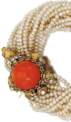 CORAL, SEED PEARL AND DIAMOND BRACELET, CARTIER, 1960S The bracelet designed as a torsade of seed pearls, decorated with a turtle set with a coral cabochon and brilliant cut -diamonds, mounted in yellow gold, French assay and maker's marks, signed Cartier Paris. length approximately 190mm,