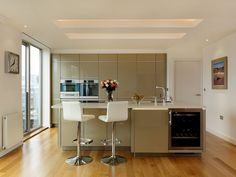 Gleed - Alno Art Pro High Gloss Champagne Kitchen - Miele Appliances - Corian Worktops