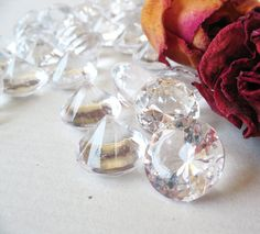 We use these clear plastic diamonds all the time! They are very inexpensive, and can be found at places like Hobby Lobby or Michaels :-)