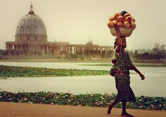Ivory Coast. Like a mirage in the dusty haze that settles over the African bush, stands an almost exact replica of St. Peter's Basilica in the Vatican City. 1989.