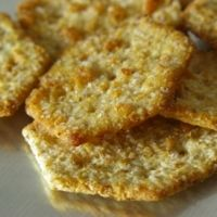 Brown rice crackers. 1 1/2 c brown rice flour, 2/3 c cooked brown rice, 1 tbs flax seeds, 1/4 c coconut or olive oil, 1/3-1/2 cup water.  Roll and bake. Gluten free!