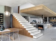 modern galley kitchen with fireplace...Glen House by SAOTA
