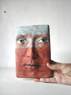 Ceramic face glazed to look like rusty metal. Find him in my Etsy shop.