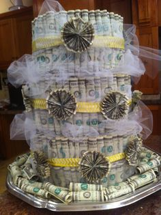 Money cake - not this style, but the accordion rosette bills is what I was picturing for a little extra