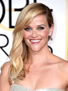 A few bobby pins to keep her hair over one shoulder took Reese Witherspoon's shiny blonde hair from cool street style to red carpet glamour.