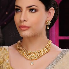 NEC/1/3437 Necklace Set with Earrings in dull gold finish studded kundan stones	 $298