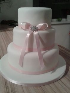 Plain ribbon wedding cake most simple cake ive done but looks nice