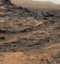 """This is an image of the fractured, rocky surface of Mars. The Curiosity rover took this picture of """"Marias Pass"""" which shows how two different type of rock units come together.  Mudstone in the center of the image comes in contact with sandstone on top."""