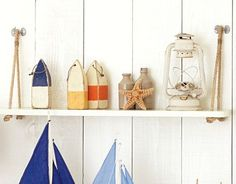 DIY Hanging Rope Shelf Ideas, I love the wall behind the shelf. Everything works so well.