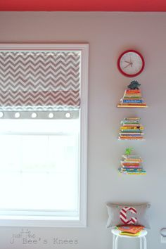 roman blinds with grommet trim, cool clock, floating shelves