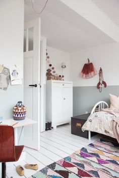 modern, relaxed bohemian little girls room with blush and blue accents and wall decor