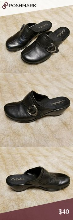 Cabelas Womens Black Leather Clogs Sz 9.5M Womens Black Leather upper Clogs. Monk strap with silver buckle closure. Very minimal wear. Some scuffs on inside heels. Very minimal and not noticeable when worn. Sz 9.5 M Cabela's Shoes Mules & Clogs