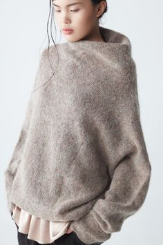 Fashion details- Extra soft mohair sweater with high collar and long sleeves by Neemic.