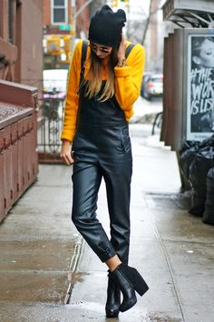 Danielle Bernstein@weworewhatofWe Wore What pairs her sculpted UPSTAGE booties with chic leather overalls and a vibrant yellow sweater. #SMOOTD