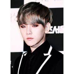 With dark red eyeliner