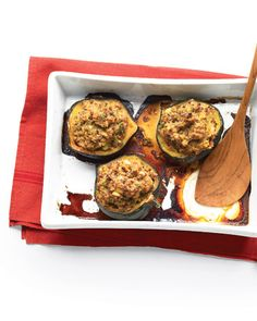 Moroccan-Style Stuffed Acorn Squashes: Turn Halved acorn squashes into built-in dishes for blend of extra-lean ground beef, bulgur, pine nuts, golden raisins, and cinnamon, Wholeliving.com