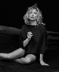 Photographed by Peter Lindbergh, Kate Moss poses in Naked Cashmere campaign