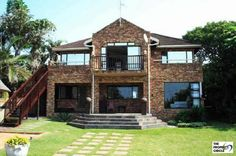 PROPERTY RAMSGATE - RAMSGATE House HIBISCUS COASTThis excellent family home is situated in Ramsgate is a mere 50 meters from the shores edge. This magnificent facebrick home boasts large air-conditioning bedrooms, a study, large living room with patio and balcony overlooking the Indian Ocean as well as the well manicured garden with large elegant swimming pool with lapa. R 1 900 000