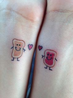 My boyfriend and i Got these Peanut butter & Jelly happy bread tattoos :3 <3