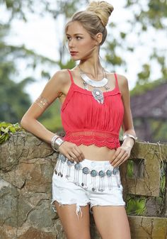 This coral lace crop top features lace hem detailing, sleeveless cut and non-stretchable cotton blend fabric. | Lookbook Store