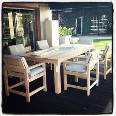 Country Table and Chairs - brand new at Essential Life - in raw Maculata wood with light blue/grey outdoor fabric.