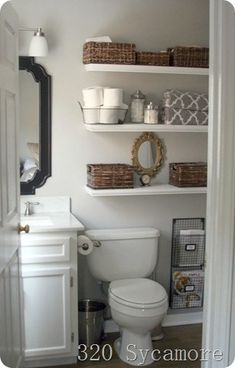 Bathroom storage...shelves above toilet with baskets, I already have the magazine rack!